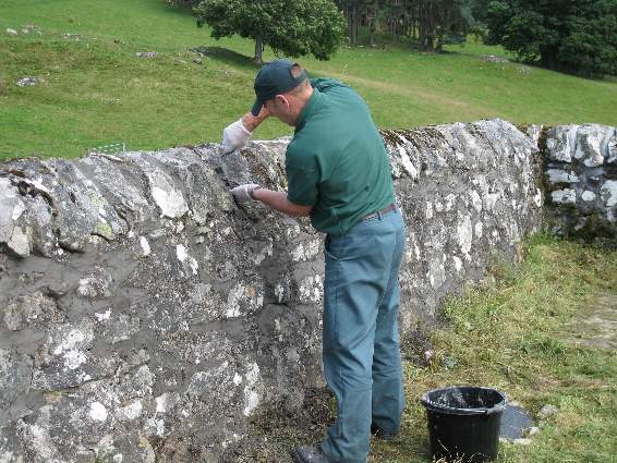 Re-pointing the walls at Borenich burial ground (July 2009)
