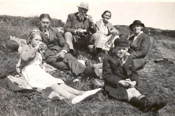 Stuart and family at the harvest, 1940